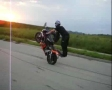 Pair does some amazing tricks on a motorcycle