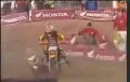 Crazy motorace accident -- rider gets dragged for 30 feet