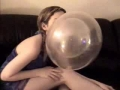 Girl does tricks with bubbles