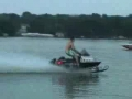 Modified snowmobile is ripping waves across a lake