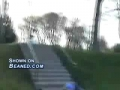 Skater eats crap on a rail