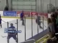 Hockey player gets checked right through the glass