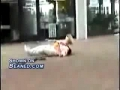 Girl on a scooter falls head first