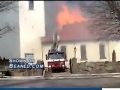 Fire sneaks under the roof and engulfs firemen