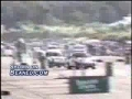 Race car skids off the track and runs over people