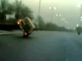 Car driving on two wheels