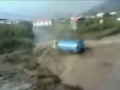 truck tries to cross very strong river