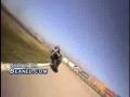 Motorcycle rider eats crap around turn