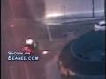 Cop drives through a concrete wall