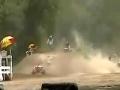 ATV rider eats crap off of a jump
