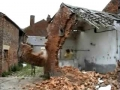 Kids knock down old building