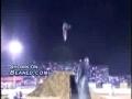 Dirt bike rider falls of bike in midair