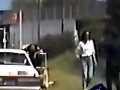 Cop dragged off