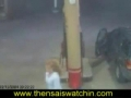 Girl pumps gas with cigarette